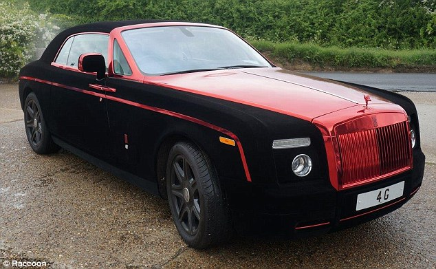 Rolls Royce wrapping include a red gold panel in the centre of the black velvet